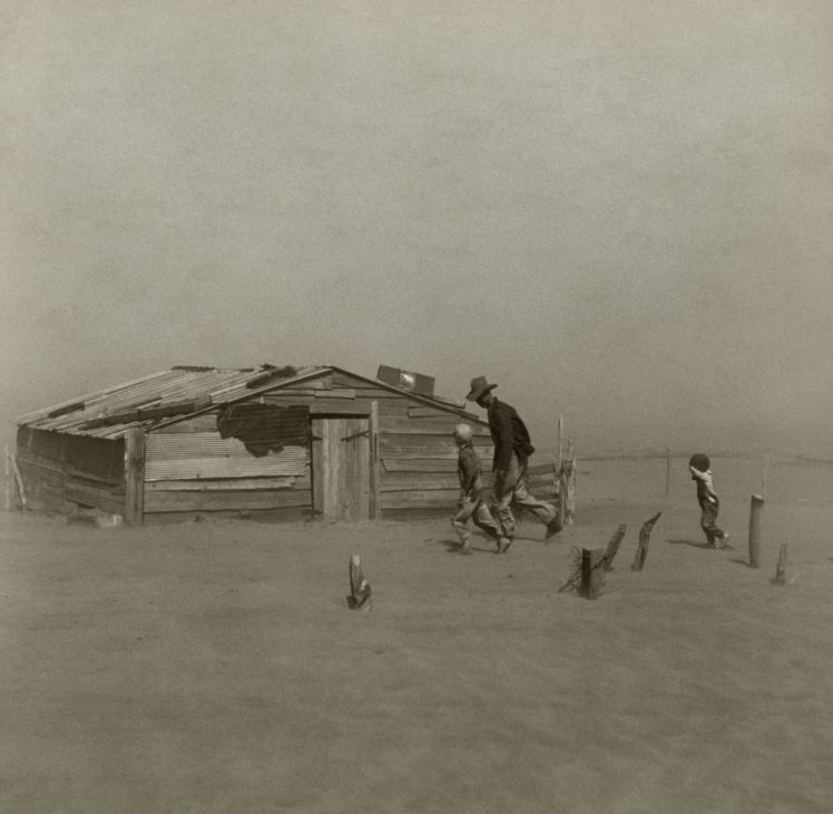 Farmer and sons during a dust storm.